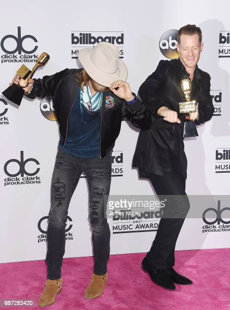 Recording artists Brian Kelley and Tyler Hubbard of the music group Florida Georgia Line pose in the press room at the 2017 Billboard Music Awards at...