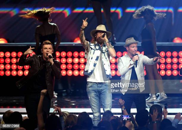 Recording artists Brian Kelley of music group Florida Georgia Line and Nick Carter and Brian Littrell of music group Backstreet Boys perform onstage...