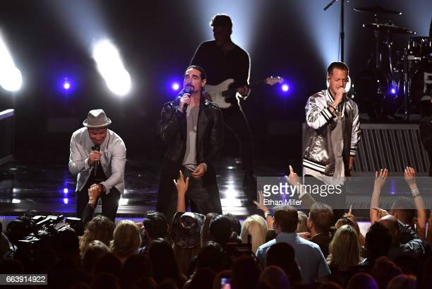 Recording artists Brian Littrell and Kevin Richardson of music group Backstreet Boys and Tyler Hubbard of music group Florida Georgia Line perform...