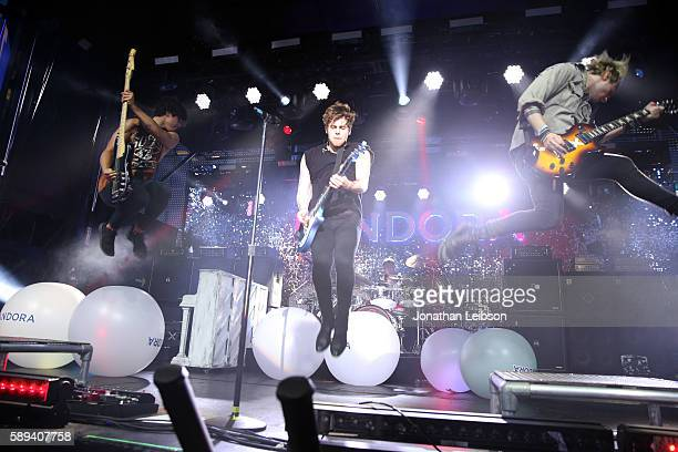 Recording artists Calum Hood Luke Hemmings Ashton Irwin and Michael Clifford of 5 Seconds of Summer perform onstage during Pandora Summer Crush at LA...