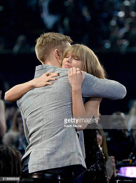 Recording artists Calvin Harris and Taylor Swift hug during the iHeartRadio Music Awards which broadcasted live on TBS TNT AND TRUTV from The Forum...