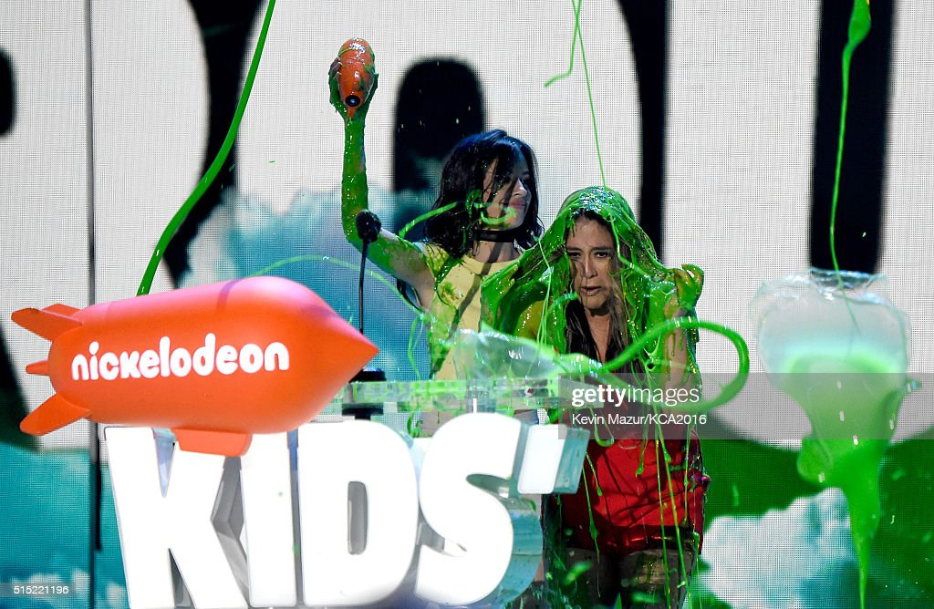 Recording artists Camila Cabello (L) and Ally Brooke of music group Fifth Harmony get slimed while accepting the Favorite Music Group award onstage during Nickelodeon's 2016 Kids' Choice Awards at The Forum on March 12, 2016 in Inglewood, California.