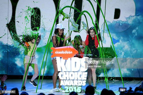 Recording artists Camila Cabello Normani Hamilton Ally Brooke and Lauren Jauregui of music group Fifth Harmony get slimed while accepting the...