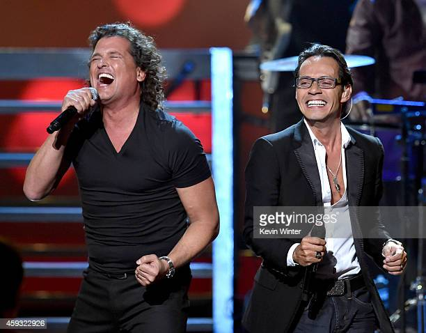 Recording artists Carlos Vives and Marc Anthony perform onstage during the 15th annual Latin GRAMMY Awards at the MGM Grand Garden Arena on November...