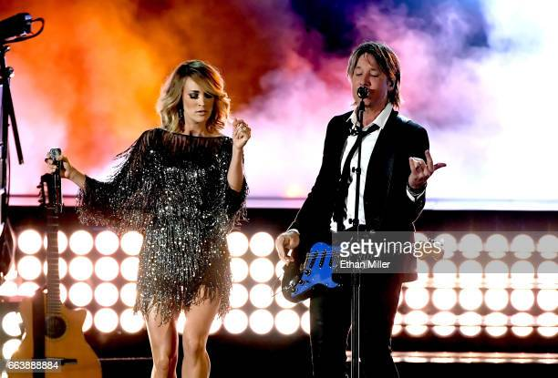 Recording artists Carrie Underwood and Keith Urban perform onstage during the 52nd Academy of Country Music Awards at T-Mobile Arena on April 2, 2017...