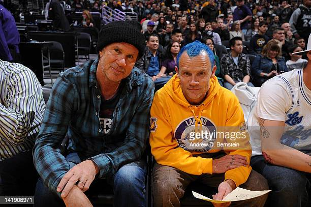 Recording artists Chad Smith and Flea of the Red Hot Chili Peppers pose for a photograph before a game between the Memphis Grizzlies and the Los...