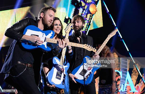 Recording artists Charles Kelley Hillary Scott and Dave Haywood of Lady Antebellum accept awards onstage during the American Country Awards 2013 at...