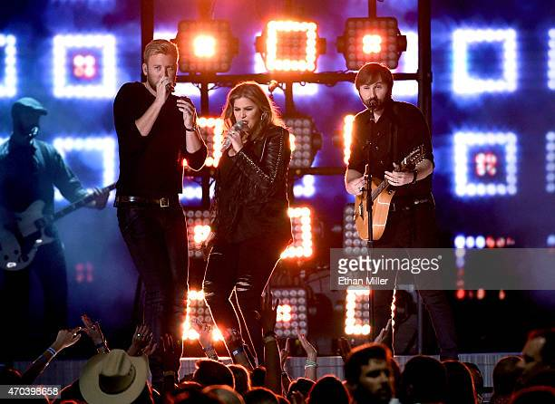 Recording artists Charles Kelley Hillary Scott and Dave Haywood of Lady Antebellum perform onstage during the 50th Academy of Country Music Awards at...