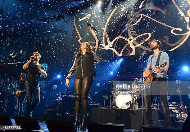 Recording artists Charles Kelley Hillary Scott and Dave Haywood of Lady Antebellum perform onstage during iHeartRadio Country Festival in Austin at...