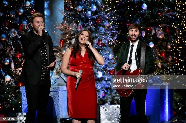 Recording artists Charles Kelley Hillary Scott and Dave Haywood of Lady Antebellum perform onstage for CMA 2017 Country Christmas at The Grand Ole...