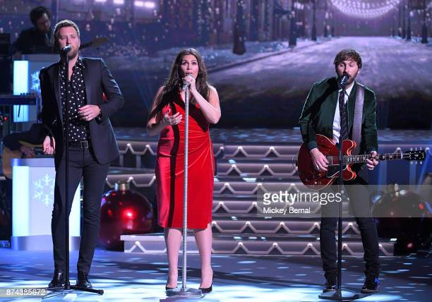Recording artists Charles Kelly Hillary Scott and Dave Haywood of Lady Antebellum perform during CMA 2017 Country Christmas at The Grand Ole Opry on...