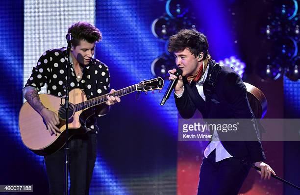 Recording artists Charley Bagnall and Jake Roche of music group Rixton perform onstage during KIIS FM's Jingle Ball 2014 powered by LINE at Staples...