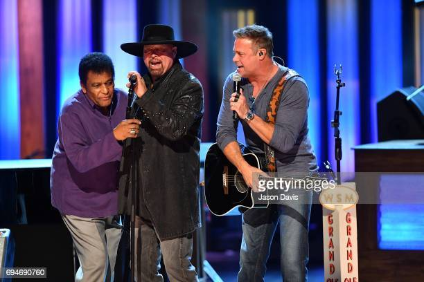 Recording Artists Charley Pride and Eddie Montgomery and Troy Gentry of Montgomery Gentry perform onstage at The Grand Ole Opry on June 10 2017 in...