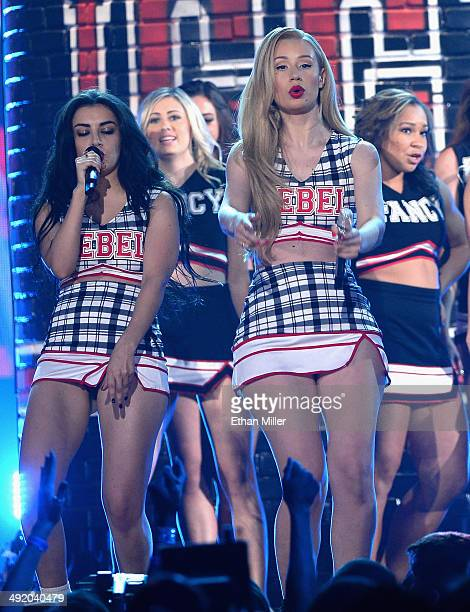 Recording artists Charli XCX and Iggy Azalea perform with UNLV cheerleaders onstage during the 2014 Billboard Music Awards at the MGM Grand Garden...