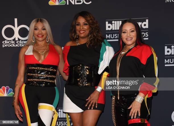 Recording artists Cheryl James DJ Spinderella and Sandra Denton of musical group SaltNPepa pose in the Press Room during the 2018 Billboard Music...