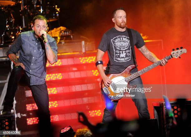 Recording artists Chester Bennington and Dave Farrell of music group Linkin Park perform onstage at the MTVu Fandom Awards during ComicCon...