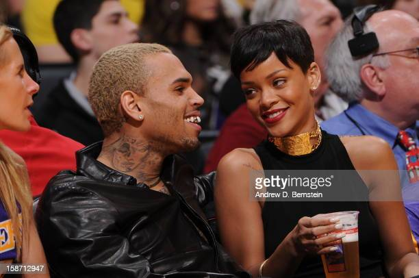 Recording artists Chris Brown and Rihanna attend a game between the New York Knicks and the Los Angeles Lakers at Staples Center on December 25 2012...