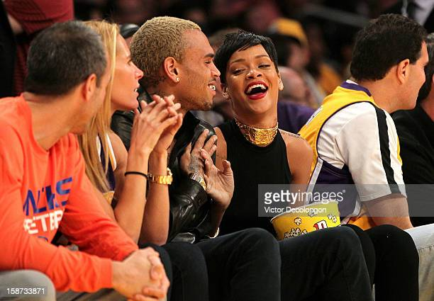 Recording artists Chris Brown and Rihanna attend the NBA game at Staples Center on December 25 2012 in Los Angeles California The Lakers defeated the...