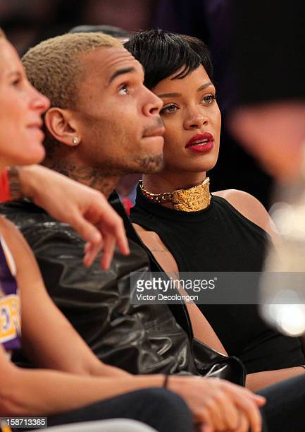 Recording artists Chris Brown and Rihanna attend the NBA game between the New York Knicks and the Los Angeles Lakers at Staples Center on December 25...