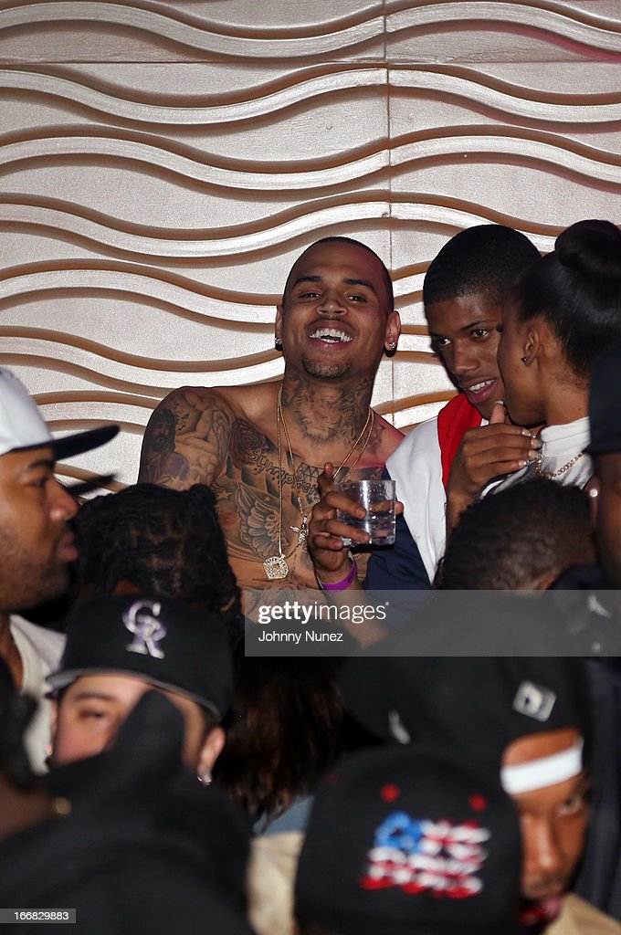 Recording artists Chris Brown (C) and The LuvaBoy TJ (R) attend the 2nd Annual DJ Prostyle Birthday Bash after party at Stage 48 on April 16, 2013, in New York City.