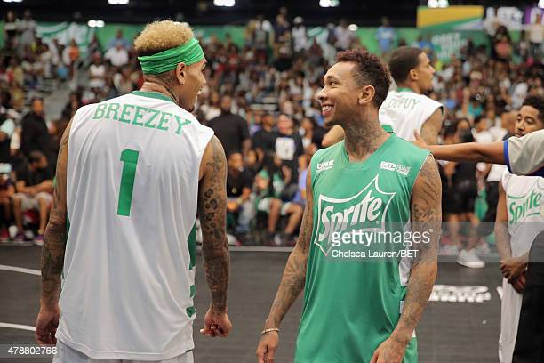 Recording artists Chris Brown and Tyga participate in the Sprite celebrity basketball game during the 2015 BET Experience at the Los Angeles...