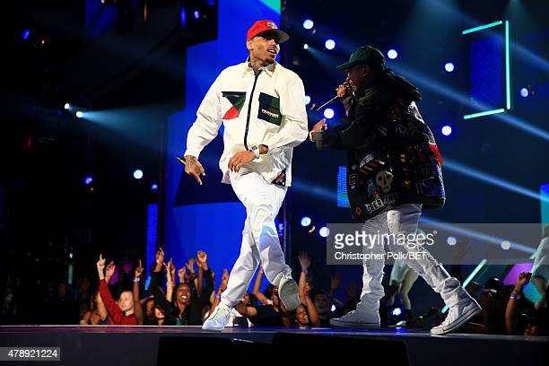 Recording artists Chris Brown and Tyga perform onstage during the 2015 BET Awards at the Microsoft Theater on June 28 2015 in Los Angeles California