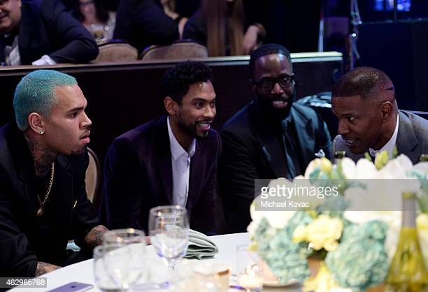 Recording artists Chris Brown Miguel and actor/recording artist Jamie Foxx attend the PreGRAMMY Gala and Salute to Industry Icons honoring Martin...
