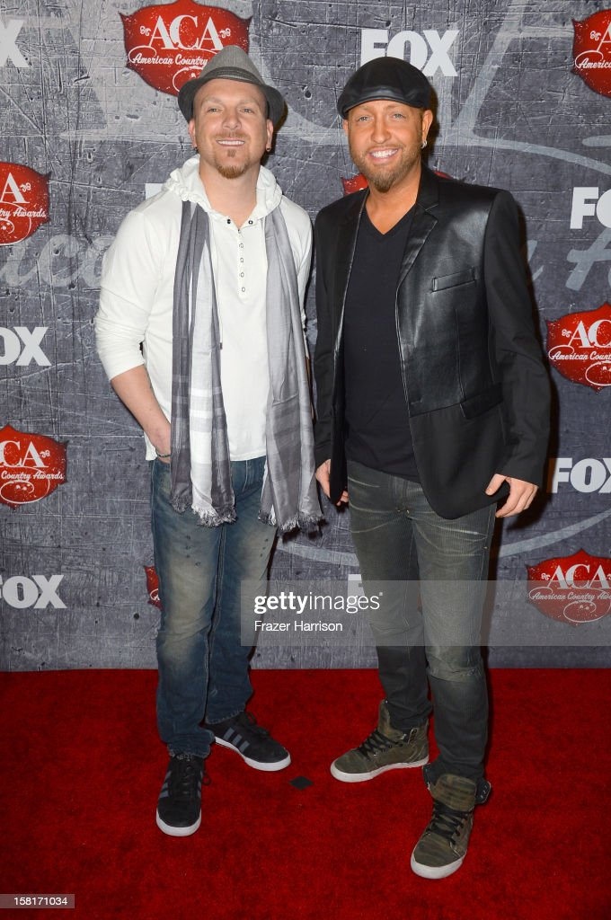 Recording artists Chris Lucas (L) and Preston Brust of the LoCash Cowboys arrive at the 2012 American Country Awards at the Mandalay Bay Events Center on December 10, 2012 in Las Vegas, Nevada.