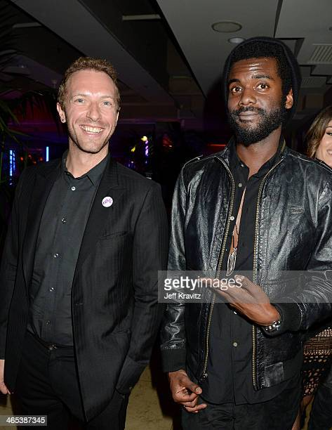 Recording artists Chris Martin and Gary Clark Jr attend the Warner Music Group annual GRAMMY celebration at Sunset Tower on January 26 2014 in West...
