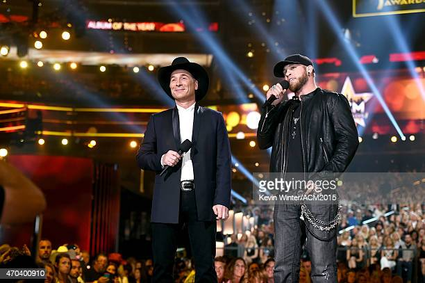 Recording artists Clint Black and Brantley Gilbert speak onstage during the 50th Academy of Country Music Awards at ATT Stadium on April 19 2015 in...