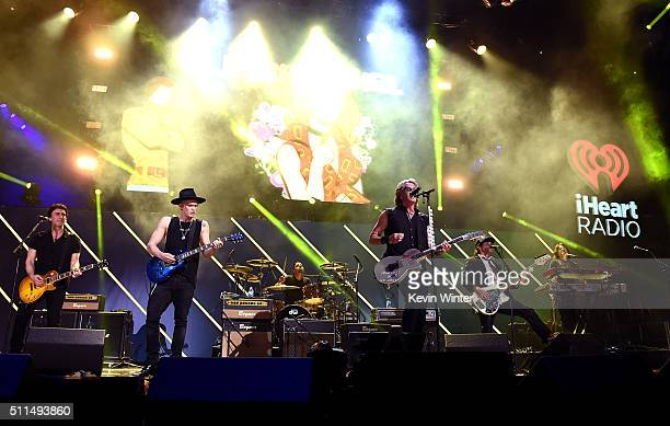 Recording artists Cody Simpson and Rick Springfield perform onstage during the first ever iHeart80s Party at The Forum on February 20 2016 in...