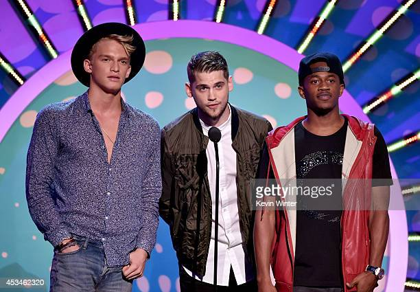Recording artists Cody Simpson Tony Oller and Malcolm David Kelley onstage during FOX's 2014 Teen Choice Awards at The Shrine Auditorium on August 10...