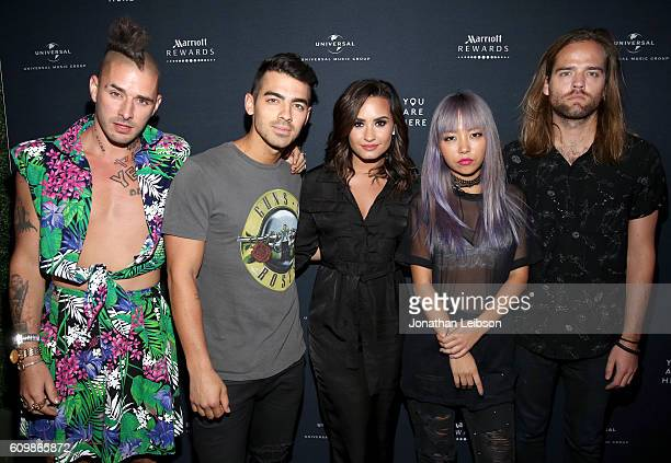 Recording artists Cole Whittle and Joe Jonas of DNCE Demi Lovato and JinJoo Lee and Jack Lawless of DNCE attend the Demi Lovato and DNCE Concert for...