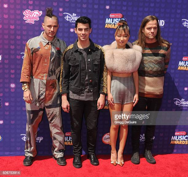 Recording artists Cole Whittle Joe Jonas JinJoo Lee and Jack Lawless of DNCE arrive at the 2016 Radio Disney Music Awards at Microsoft Theater on...