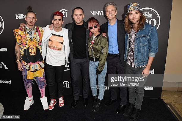 Recording artists Cole Whittle Joe Jonas of DNCE manager Phil McIntyre musician JinJoo Lee of DNCE president of Clear Channel John Sykes and musician...