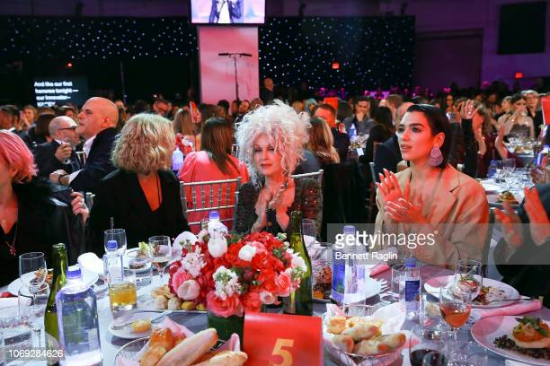 Recording artists Cyndi Lauper and Dua Lipa attend the Billboard's Women In Music 2018 with FIJI water at Pier 36 on December 6 2018 in New York City