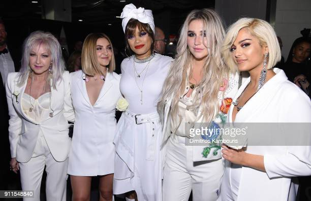 Recording artists Cyndi Lauper Julia Michaels Andra Day Kesha and Bebe Rexha pose backstage during the 60th Annual GRAMMY Awards at Madison Square...