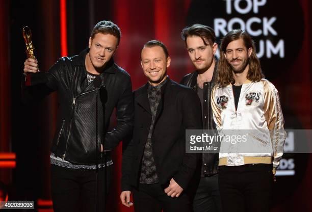 Recording artists Dan Reynolds Ben McKee Daniel Platzman and Wayne Sermon of Imagine Dragons accept the Top Rock Album award for 'Night Visions'...