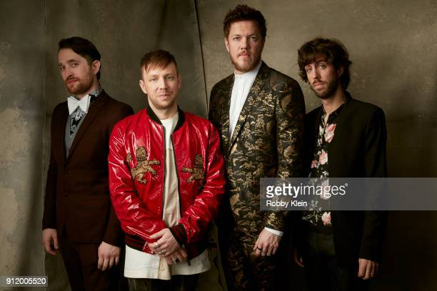 Recording artists Daniel Platzman Ben McKee Dan Reynolds and Wayne Sermon of musical group Imagine Dragons pose for a photo during MusiCares Person...