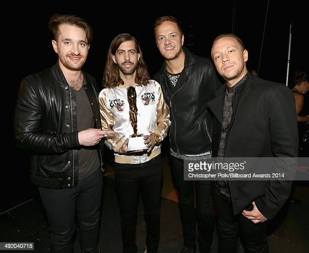 Recording artists Daniel Platzman Wayne Sermon Dan Reynolds and Ben McKee of Imagine Dragons attend the 2014 Billboard Music Awards at the MGM Grand...