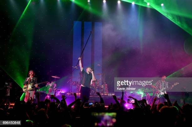 Recording artists Daniel Wayne Sermon, Dan Reynolds, and Daniel Platzman of Imagine Dragons perform at Imagine Dragons Live presented by Citi and...