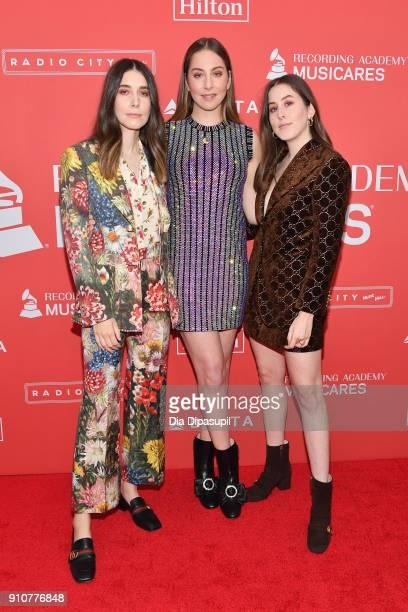 Recording artists Danielle Haim Este Haim and Alana Haim of music group Haim attend MusiCares Person of the Year honoring Fleetwood Mac at Radio City...