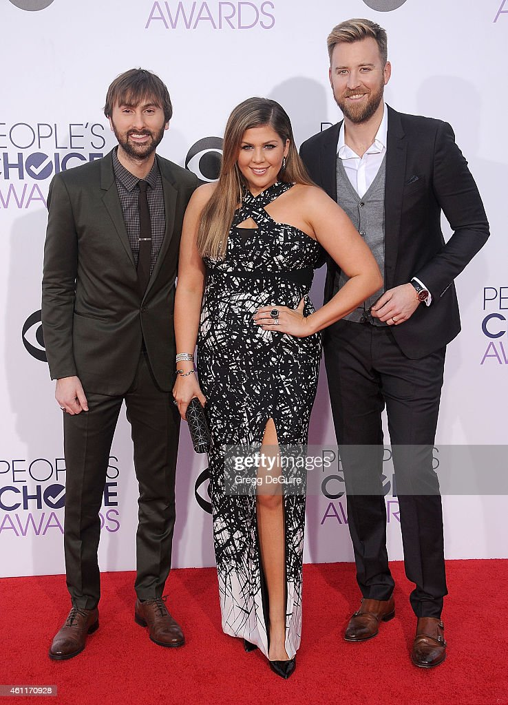 Recording artists Dave Haywood, Hillary Scott and Charles Kelley of music group Lady Antebellum arrive at The 41st Annual People's Choice Awards at Nokia Theatre LA Live on January 7, 2015 in Los Angeles, California.