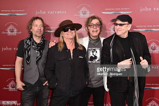 Recording artists Daxx Nielsen Robin Zander Tom Petersson and Rick Nielsen of music group Cheap Trick attend the John Varvatos 13th Annual Stuart...