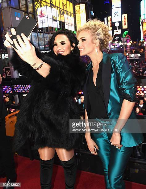 Recording artists Demi Lovato and Carrie Underwood pose for a selfie at the Dick Clark's New Year's Rockin' Eve with Ryan Seacrest 2016 on December...