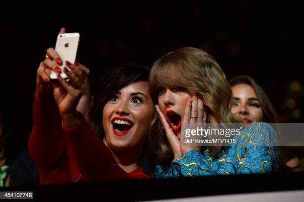 Recording artists Demi Lovato and Taylor Swift take a selfie at the 2014 MTV Video Music Awards at The Forum on August 24 2014 in Inglewood California