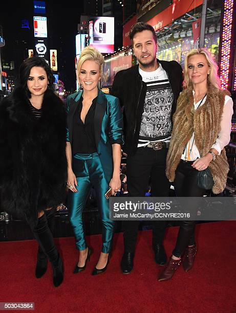Recording artists Demi Lovato Carrie Underwood Luke Bryan and Caroline Boyer pose at the Dick Clark's New Year's Rockin' Eve with Ryan Seacrest 2016...