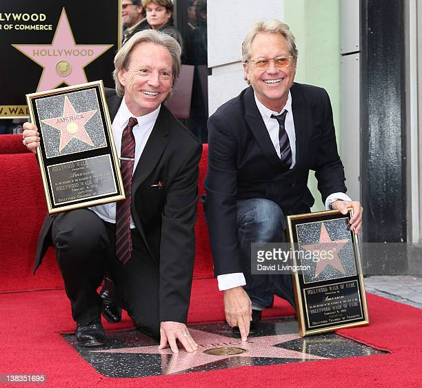 Recording artists Dewey Bunnell and Gerry Beckley attend the band America being honored with a Star on the Hollywood Walk of Fame on February 6 2012...