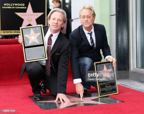 Recording artists Dewey Bunnell and Gerry Beckley of the band America pose for photos as America is honored with a Star on the Hollywood Walk of Fame...
