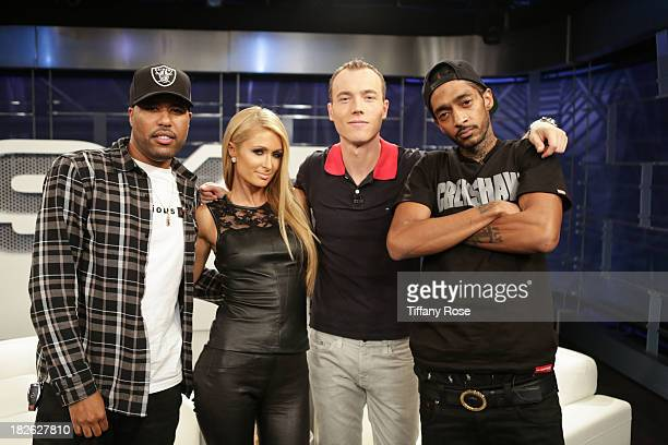 Recording Artists Dom Kennedy Paris Hilton DJ SKEE and Nipsey Hussle pose for SKEE Live at The Conga Room in LA Live on October 1 2013 in Los Angeles...